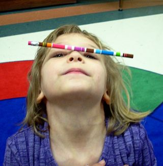 Balance a pencil on your nose